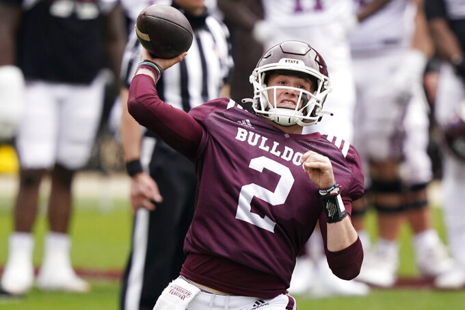 Maroon quarterback Will Rogers (2) braces as he passes during Mississippi State's Maroon and White spring NCAA college football game, Saturday, April 17, 2021, in Starkville, Miss. The White team won 30-22. (AP Photo/Rogelio V. Solis)