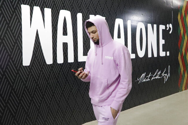 FILE - In this Feb. 5, 2020, file photo, Denver Nuggets guard Jamal Murray arrives at the Vivint Smart Home Arena before the start of their NBA basketball game against the Utah Jazz in Salt Lake City. f so inclined, NBA teams like Miami, Orlando and Utah could all be back in the gym for voluntary workouts in small groups starting Friday, May 8, when the league ban on such things expires. None of them will be reopening that day. There's a clear desire for basketball to resume but, perhaps mindful of how rushing back too quickly hurt other leagues around the world, the NBA seems to be taking very cautious baby steps back to the court. (AP Photo/Rick Bowmer, File)