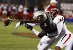 UNLV Rebels wide receiver Mekhi Stevenson (2) misses a catch while covered by Fresno State Bulldogs defensive back Jaron Bryant during the first half of an NCAA college football game Saturday, Nov. 3, 2018, in Las Vegas. (AP Photo/John Locher)