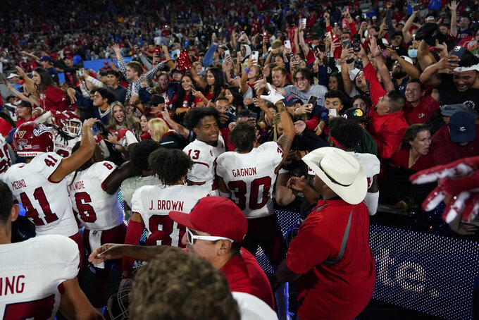 Fresno State Players celebrate with fans after a win over UCLA in an NCAA college football game Sunday, Sept. 19, 2021, in Pasadena, Calif. (AP Photo/Marcio Jose Sanchez)