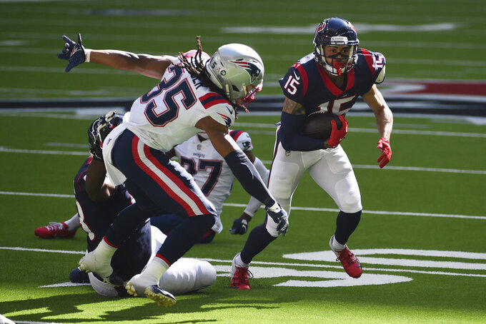 Houston Texans wide receiver Will Fuller (15) runs past New England Patriots safety Kyle Dugger (35) during the first half of an NFL football game, Sunday, Nov. 22, 2020, in Houston. (AP Photo/Eric Christian Smith)