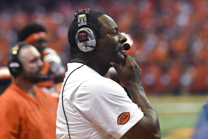 Syracuse coach Dino Babers watches a Clemson touchdown during the first half of an NCAA college football game Saturday, Sept. 14, 2019, in Syracuse, N.Y. (AP Photo/Steve Jacobs)
