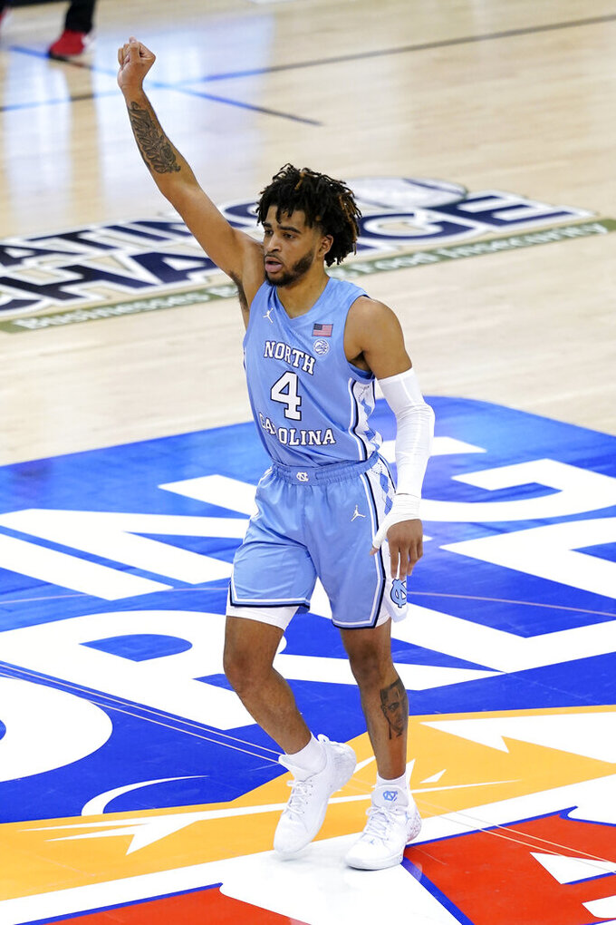 North Carolina guard R.J. Davis (4) celebrates his three-point basket against UNLV in the second half of an NCAA college basketball game in the Maui Invitational tournament, Monday, Nov. 30, 2020, in Asheville, N.C. (AP Photo/Kathy Kmonicek)