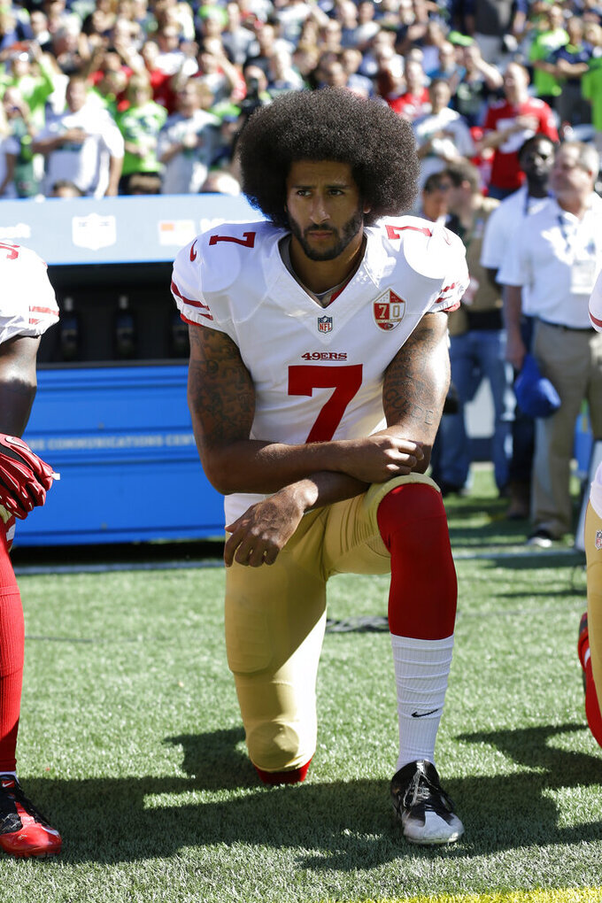 FILE - In this Sept. 25, 2016, file photo, San Francisco 49ers' Colin Kaepernick kneels during the national anthem before an NFL football game against the Seattle Seahawks in Seattle. The NFL, which has raised $44 million in donations through its Inspire Change program, announced the additional $206 million commitment Thursday, June 11, 2020. Kaepernick and others began kneeling during the national anthem in 2016 to protest social injustice and police brutality. He has not found an NFL job the last three seasons. (AP Photo/Ted S. Warren, File)