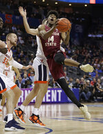 Florida State's Terance Mann (14) is fouled as he drives against against Virginia during the first half of an NCAA college basketball game in the Atlantic Coast Conference tournament in Charlotte, N.C., Friday, March 15, 2019. (AP Photo/Nell Redmond)