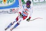 Switzerland's Gino Caviezel arrives at the finish area of an alpine ski, men's World Cup Super G, in Saalbach-Hinterglemm, Austria, Friday, Feb. 14, 2020. (AP Photo/Giovanni Auletta)