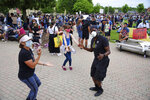 Several people dance at a Black Lives Matter rally for George Lloyd, a black man who died while being restrained by Minneapolis police on Memorial Day, at the Peg Bond Pavilion in Batavia Wednesday, June 3, 2020. (John Starks/Daily Herald, via AP)