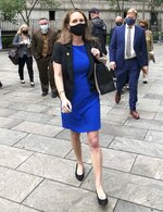Natalie Mayflower Sours Edwards, center, leaves court after receiving a six-month prison sentence for leaking confidential financial reports to a journalist at Buzzfeed, Thursday June 3, 2021, in New York. (AP Photo/Larry Neumeister)