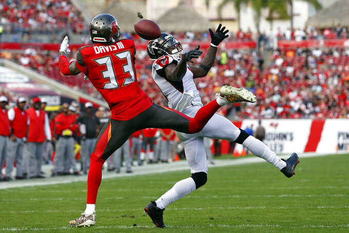 Tampa Bay Buccaneers cornerback Carlton Davis III (33) breaks up a pass intended for Atlanta Falcons wide receiver Julio Jones (11) during the first half of an NFL football game Sunday, Dec. 29, 2019, in Tampa, Fla. (AP Photo/Mark LoMoglio)