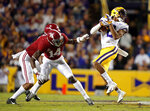 LSU wide receiver Justin Jefferson (2) pulls in a first down reception against Alabama defensive back Deionte Thompson (14) and defensive back Patrick Surtain II (2) in the first half of an NCAA college football game in Baton Rouge, La., Saturday, Nov. 3, 2018. (AP Photo/Gerald Herbert)