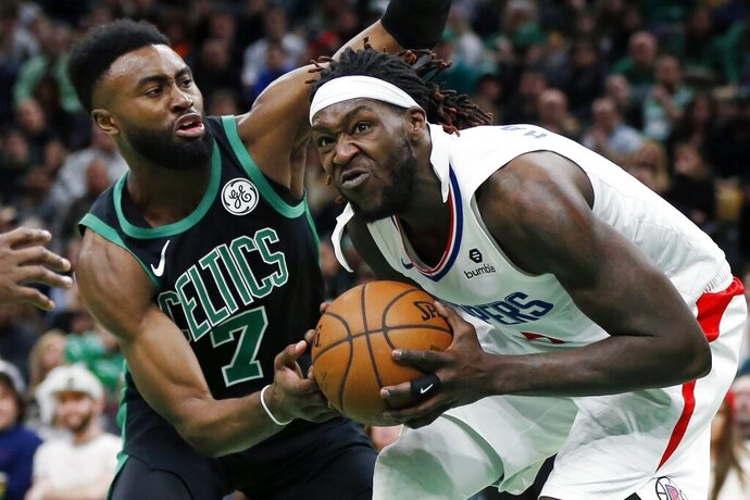 Boston Celtics' Jaylen Brown (7) defends against Los Angeles Clippers' Montrezl Harrell (5) during the second half of an NBA basketball game in Boston, Saturday, Feb. 9, 2019. (AP Photo/Michael Dwyer)