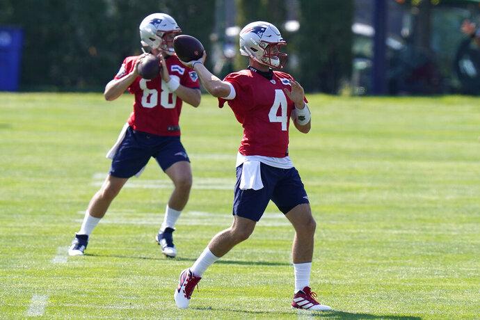 New England Patriots quarterbacks Brian Lewerke (68) and Jarrett Stidham (4) warm up during an NFL football training camp practice, Sunday, Aug. 23, 2020, in Foxborough, Mass. (AP Photo/Steven Senne, Pool)