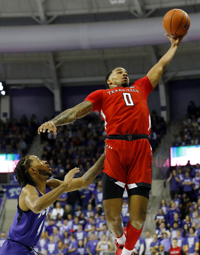 Texas Tech guard Kyler Edwards, right, grabs the loose ball in front of TCU guard PJ Fuller, left, during the first half of an NCAA college basketball game in Fort Worth, Texas, Tuesday, Jan. 21, 2020. (AP Photo/Ray Carlin)