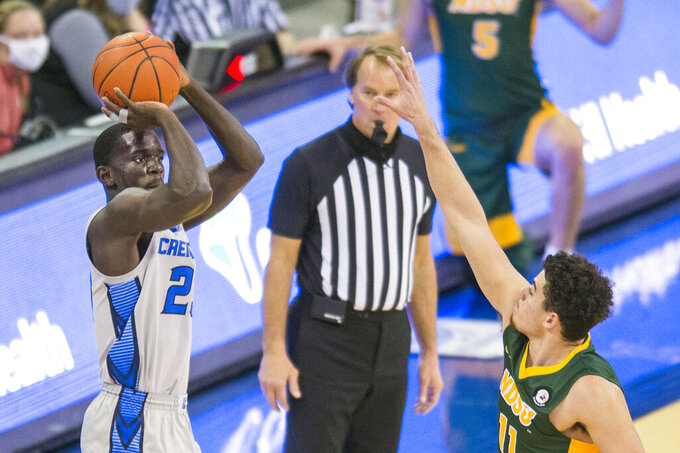 Creighton's Damien Jefferson scores against North Dakota State's Jarius Cook during the second half of an NCAA college basketball game in Omaha, Neb., Sunday, Nov. 29, 2020. (AP Photo/Kayla Wolf)