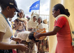 World Food Programme (WFP) workers screen for malnutrition and distribute food to communities in the Adi Daero district of the Tigray region of northern Ethiopia Saturday, Aug. 21, 2021. (Claire Nevill/WFP via AP)