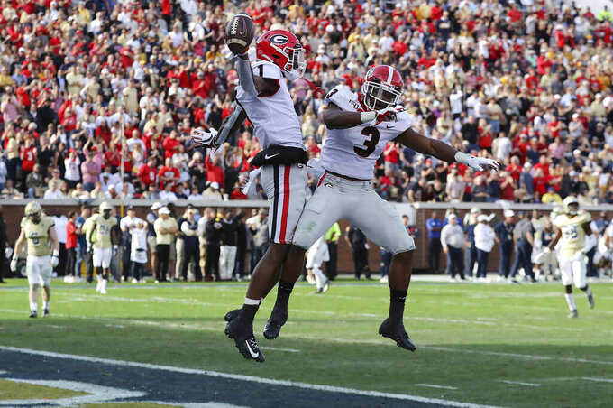 Georgia wide receiver George Pickens, left,celebrates his touchdown reception with tailback Zamir White during the third quarter of an NCAA college football game against Georgia Tech Saturday, Nov. 30, 2019, in Atlanta. (Curtis Compton/Atlanta Journal-Constitution via AP)