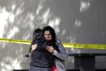 Mourners embrace outside of the Thousand Oaks Teen Center on Thursday, Nov. 8, 2018, where relatives and friends gathered in the aftermath of the Wednesday night mass shooting, in Thousand Oaks, Calif. Multiple people were shot and killed late Wednesday by a gunman who opened fire at the Borderline Bar & Grill, which was holding a weekly country music dance night for college students. (AP Photo/Marcio Jose Sanchez)