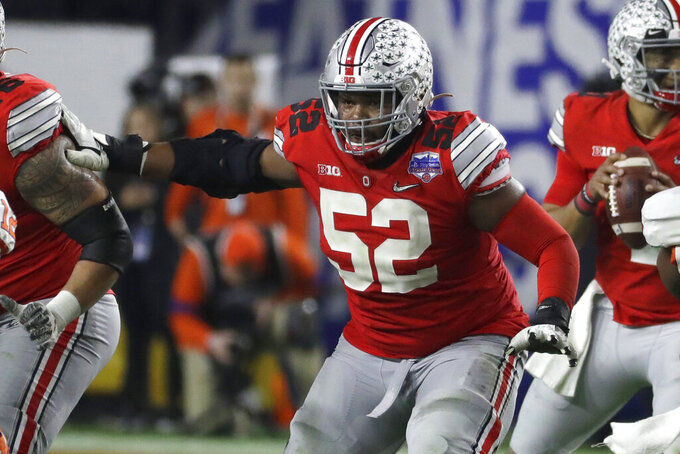 FILE - In this Dec. 28, 2019, file photo, Ohio State offensive lineman Wyatt Davis (52) plays during the first half of the Fiesta Bowl NCAA college football game against Clemson, in Glendale, Ariz. Davis was selected to The Associated Press preseason All-America first-team, Tuesday, Aug. 25, 2020. (AP Photo/Rick Scuteri, File)