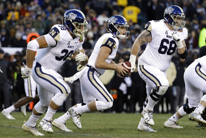 Navy's Zach Abey, center, scrambles during the first half of an NCAA college football game against Army, Saturday, Dec. 8, 2018, in Philadelphia. (AP Photo/Matt Slocum)