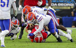 Georgia quarterback Stetson Bennett (13) is taken down at the line of scrimmage by Florida defensive lineman Kyree Campbell (55) during the first half of a NCAA college football, Saturday, Nov. 7, 2020, in Jacksonville, Fla. (Curtis Compton/Atlanta Journal-Constitution via AP)