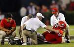 Georgia offensive lineman Solomon Kindley (66) is tended to by the medical staff after being injured during the first half of an NCAA college football game against Vanderbilt on Saturday, Oct. 6, 2018, in Atlanta. (AP Photo/John Bazemore)