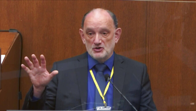 In this image from video, Dr. David Fowler, a retired forensic pathologist and former chief medical examiner for the state of Maryland testifies as Hennepin County Judge Peter Cahill presides, Wednesday, April 14, 2021, in the trial of former Minneapolis police Officer Derek Chauvin at the Hennepin County Courthouse in Minneapolis, Minn. Chauvin is charged in the May 25, 2020 death of George Floyd. (Court TV via AP, Pool)