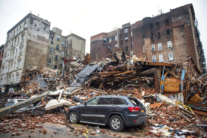 FILE - In this March 27, 2015, file photo, a pile of debris remains at the site of a building explosion in the East Village neighborhood of New York. Three people were convicted of manslaughter, Friday, Nov. 15, 2019, in the 2015 East Village building explosion that killed two men. (Nancy Borowick/The New York Times via AP, Pool)