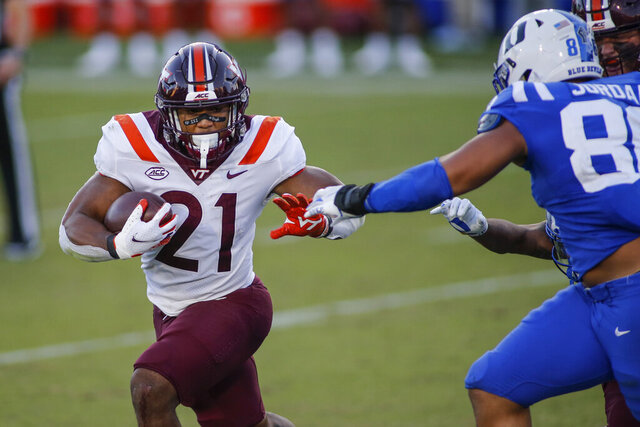 Virginia Tech running back Khalil Herbert (21) carries the ball against Duke during the second half of an NCAA college football game Saturday, Oct. 3, 2020, in Durham, N.C. (Nell Redmond/Pool Photo via AP)
