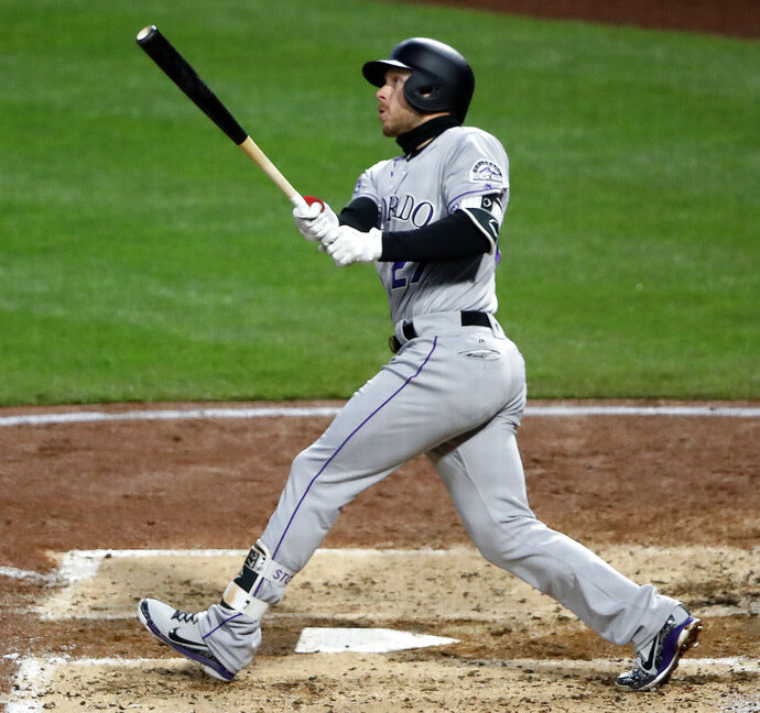Colorado Rockies' Trevor Story (27) watches his three-run home run off Pittsburgh Pirates starting pitcher Steven Brault in the fourth inning of a baseball game in Pittsburgh, Monday, April 16, 2018. (AP Photo/Gene J. Puskar)