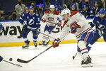 Montreal Canadiens center Nick Suzuki shoots during the third period in Game 5 of the NHL hockey Stanley Cup finals against the Tampa Bay Lightning, Wednesday, July 7, 2021, in Tampa, Fla. (AP Photo/Phelan Ebenhack)