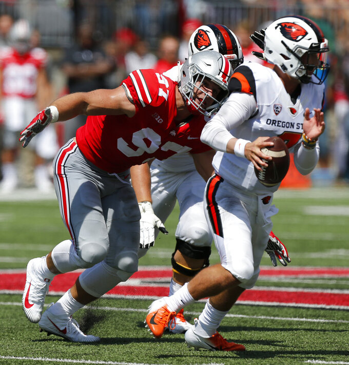 Ohio State defensive lineman Nick Bosa, left, sacks Oregon State quarterback Conor Blount during the first half of an NCAA college football game Saturday, Sept. 1, 2018, in Columbus, Ohio. (AP Photo/Jay LaPrete)