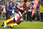 San Francisco 49ers fullback Kyle Juszczyk, top, runs toward the end zone to score against Green Bay Packers strong safety Adrian Amos during the second half of an NFL football game in Santa Clara, Calif., Sunday, Sept. 26, 2021. (AP Photo/Tony Avelar)