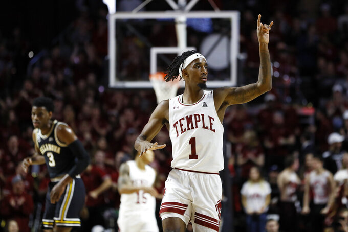 Temple's Quinton Rose (1) reacts after making a basket during the first half of an NCAA college basketball game against Villanova, Sunday, Feb. 16, 2020, in Philadelphia. (AP Photo/Matt Slocum)