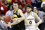 Iowa's Joe Wieskamp (10) drives past Cincinnati's Logan Johnson (0) in the second half during a first round men's college basketball game in the NCAA Tournament in Columbus, Ohio, Friday, March 22, 2019. Iowa won 79-72. (AP Photo/Tony Dejak)