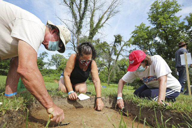 Carl Bujanowski, left, of Poynette, with his wife, Jill, right, join Gwen Heath, of Packwaukee, to search for artifacts during an archaeological dig on the grounds of the Historic Indian Agency House in Portage, Wis., Saturday, July 25, 2020. The effort is an attempt to locate a blacksmith shop established in the 1830s. (Amber Arnold/Wisconsin State Journal via AP)
