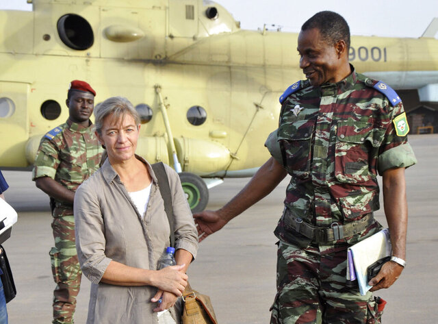 "FILE - In this April 24, 2012, file photo, released Swiss hostage Beatrice Stoeckli, left, stands in Ouagadougou, Burkina Faso, following arrival by helicopter from Timbuktu, Mali, after being handed over by militant Islamic group Ansar Dine. Switzerland's Foreign Ministry said Friday, Oct. 8, 2020, that Stoeckli has been killed by an Islamist group. The ministry said it was informed by French authorities that the hostage had been ""killed by kidnappers of the Islamist terrorist organization Jama'at Nusrat al-Islam Muslimeen about a month ago."" Stoeckli was kidnapped four years ago. (AP Photo/Brahima Ouedraogo, File)"