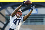 New England Patriots fullback Jakob Johnson (47) catches a pass during an NFL football practice Friday, Aug. 6, 2021, in Foxborough, Mass. (AP Photo/Elise Amendola)