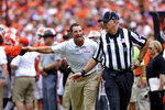 Clemson head coach Dabo Swinney reacts and discusses a call with an official during the first half of an NCAA college football game against Syracuse, Saturday, Sept. 29, 2018, in Clemson, S.C. (AP Photo/Richard Shiro)
