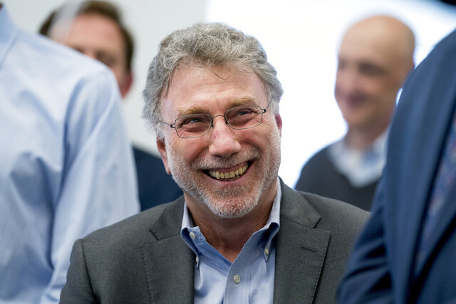 FILE- In this April 16, 2018, file photo, Washington Post Executive Editor Martin Baron smiles during a newsroom celebration after newspaper won two pulitzer prizes. Baron delivered the Harvard University commencement address virtually over a video feed to graduates on Thursday, May 28, 2020, due to the coronavirus outbreak. (AP Photo/Andrew Harnik, File)