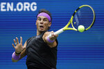 Rafael Nadal, of Spain, returns a shot to Daniil Medvedev, of Russia, during the men's singles final of the U.S. Open tennis championships Sunday, Sept. 8, 2019, in New York. (AP Photo/Adam Hunger)
