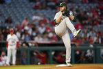 Oakland Athletics starting pitcher Cole Irvin (19) throws during the first inning of a baseball game against the Los Angeles Angels Friday, Sept. 17, 2021, in Anaheim, Calif. (AP Photo/Ashley Landis)