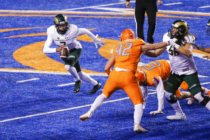Colorado State quarterback Todd Centeio (7) scrambles out of the pocket to avoid pressure from the Boise State defense during the fourth quarter of an NCAA college football game Thursday, Nov. 12, 2020, in Boise, Idaho. Boise State won 52-21. (AP Photo/Steve Conner)