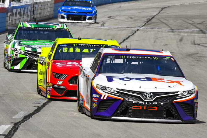Drive Denny Hamlin (11) races down the front stretch during a NASCAR Cup auto race at Texas Motor Speedway, Sunday, March 31, 2019, in Fort Worth, Texas. Hamlin would win the race. (AP Photo/Larry Papke)