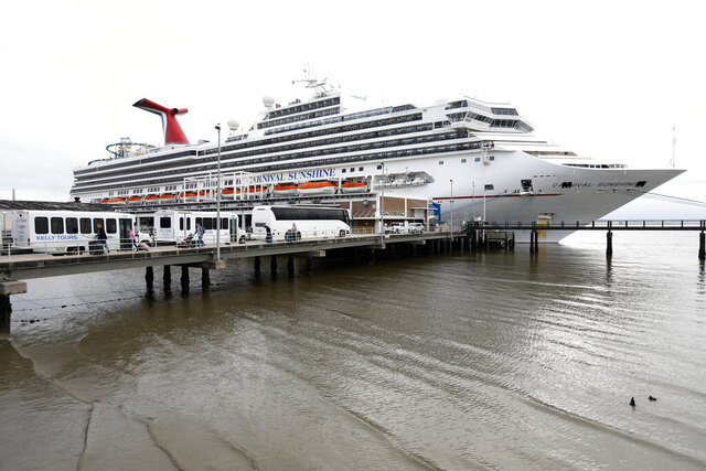 FILE - Passengers disembark from the Carnival Sunshine cruise ship Monday, March 16, 2020, in Charleston, S.C. Carnival Corp. said Monday, Jan. 11, 2021 its 2022 cruise bookings are running ahead of 2019 numbers, a good sign that guests will return once the pandemic has eased. The coronavirus has been devastating for the cruise industry, which had expected to welcome 30 million passengers worldwide in 2020. (AP Photo/Mic Smith, file)