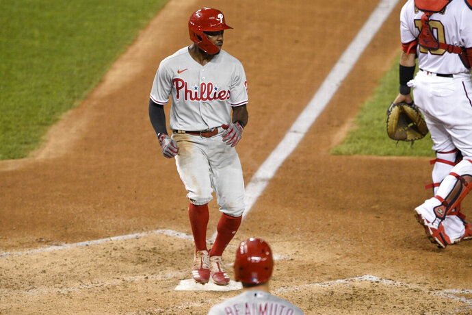 Philadelphia Phillies' Roman Quinn scores on a single by Bryce Harper during the seventh inning of the team's baseball game against the Washington Nationals, Wednesday, Aug. 26, 2020, in Washington. (AP Photo/Nick Wass)