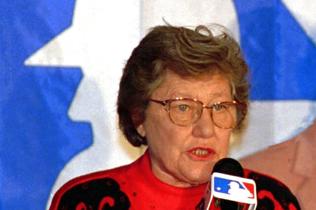 FILE - This is a Dec. 10, 1992, file photo showing Cincinnati Reds owner Marge Schott speaks at a news conference in Louisville, Ky. The University of Cincinnati is removing Marge Schott's name from its baseball stadium and a library archive in light of her racist comments while owner of the Cincinnati Reds. The school's board of trustees unanimously approved the move Tuesday, June 23, 2020, a dozen days after a Catholic high school also decided to remove references to Schott from its facilities. Over the years, UC students, faculty at alumni have objected to Schott's name on school facilities, but no changes were made. (AP Photo/John Goff, File)