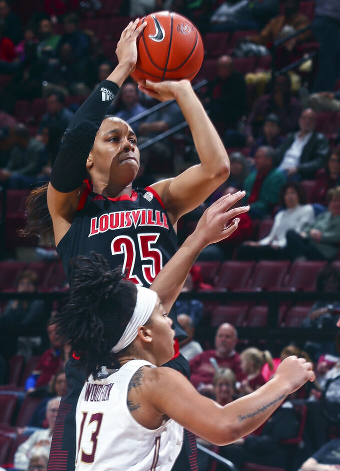 Louisville guard Asia Durr (25) shoots over Florida State guard Nausia Woolfolk (13) during the second half of an NCAA college basketball game in Tallahassee, Fla., Thursday, Jan. 24, 2019. (AP Photo/Phil Sears)