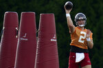 Tampa Bay Buccaneers quarterback Kyle Trask (2) throws a pass during an NFL football practice Tuesday, July 27, 2021, in Tampa, Fla. (AP Photo/Chris O'Meara)