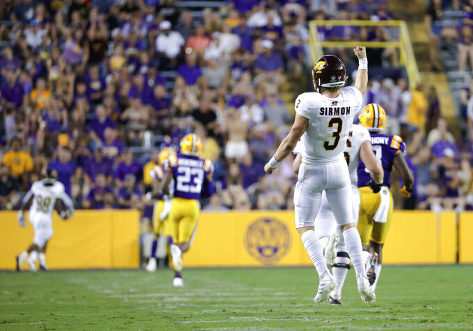 Central Michigan quarterback Jacob Sirmon (3) celebrates after a touchdown pass against LSU during the first quarter of an NCAA college football game in Baton Rouge, La,. Saturday, Sept. 18, 2021. (AP Photo/Derick Hingle)