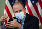 Colorado Governor Jared Polis makes a point during a news conference about the state's spike in cases of the new coronavirus Tuesday, Oct. 13, 2020, in Denver. (AP Photo/David Zalubowski)